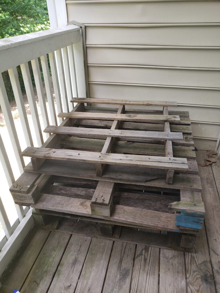 Photo of old wooden pallets before the makeover.